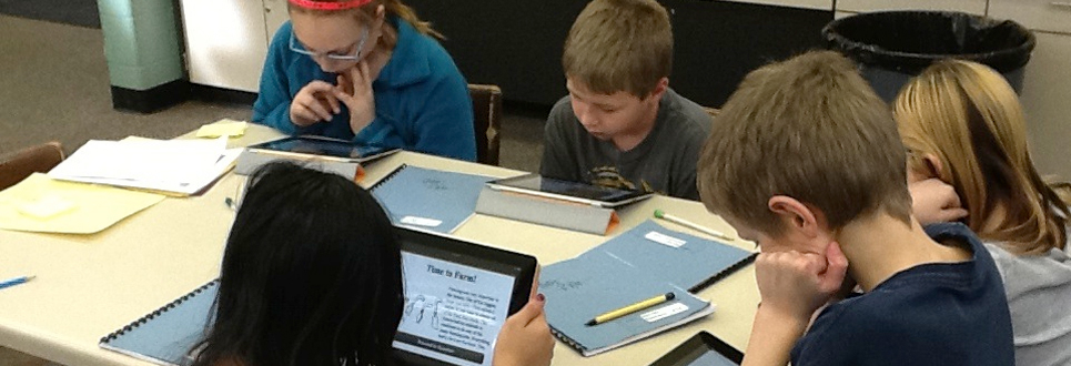Female and male students working on iPads